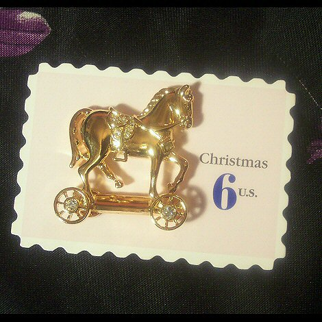 Avon Smithsonian Christmas Toy Horse Brooch